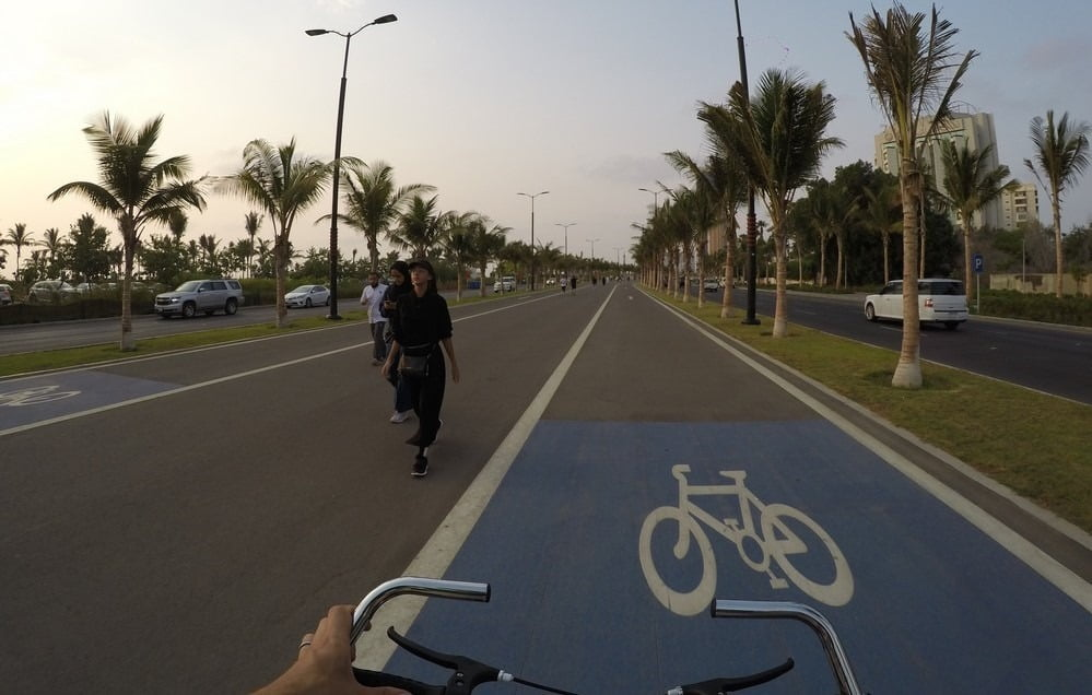 A wide bike path with much space for both lines of traffic and pedestrians in a alley of palm trees. We used this frequently during preparation of 88th National Day in Jeddah, Saudi Arabia.