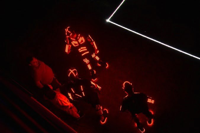 Players wearing LED costumes in RED before the match