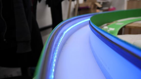 One of the rings with LED strip attached inside with silicone. Strip used - digital, 60 diodes/meter. Testing mode with Blue color.