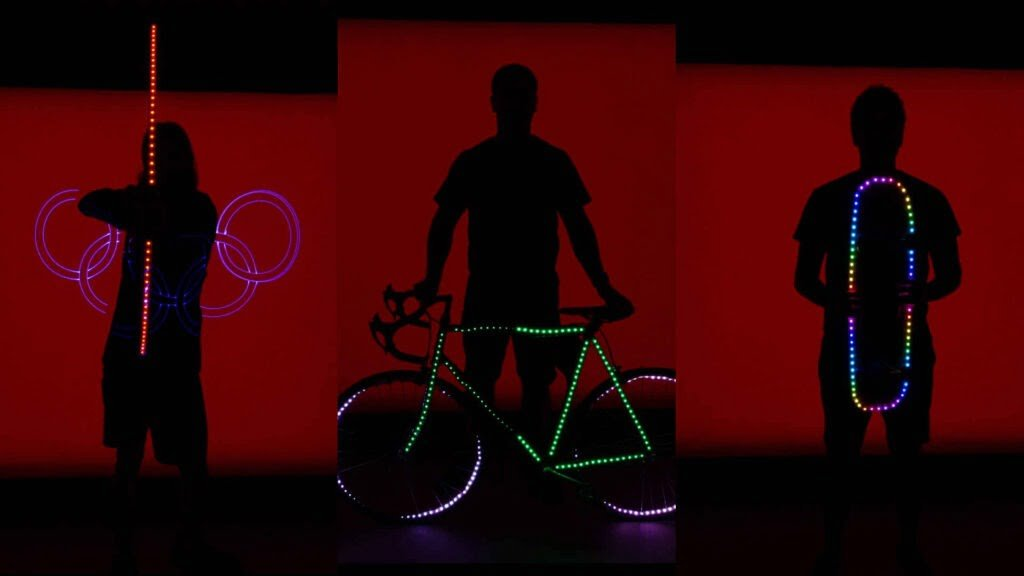 An LED bicycle with strips on wheels and center tube, LED skareboard and LED bow